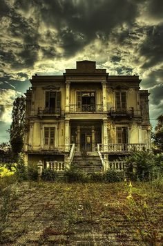 Abandoned home. Obviously not my dream home right now, but if you could envision this place fixed up its exactly my style. Love the balconies and floor to ceiling windows/doors.