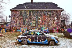 """photo by Scott Kreider. The Heidelberg Project is an art environment that spans 2 Detroit city blocks. Attaching found items on the walls of deserted homes, the heidelberg project transformed the structures into """"gigantic art sculptures."""" The houses are still abandoned."""