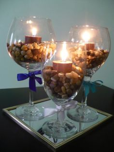 Using wine glasses for centerpieces. http://www.prakticideas.com/wine-glass-centerpiece/