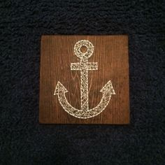 Anchor String Art for my baby boys nautical nursery. Purchased through Etsy from my cousin. She has a natural artists touch! Have something in mind that needs to be created, contact her at The Essential Part!  You won't be disappointed :)  http://www.etsy.com/shop/theessentialpart