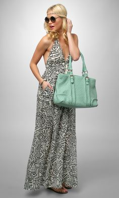 Bohemian styling for a printed halter maxi dress. #music #fashion #outfit #inspiration