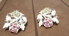 White rhinestone vintage earrings https://www.etsy.com/listing/155559823/white-rhinestone-earrings-vintage-floral?ref=shop_home_active