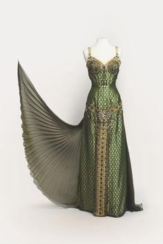 Costume from Cosprop DESIGN EGYPTIAN BROCADE GREEN GOLD JEWELS LACE BEADING BEADS SHEER PLEATS METALLIC