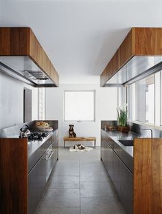 stainless steel kitchen with warm wood