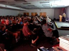 "SRO crowd hears Rick Smith talk about his father Patrick, author of ""A Land Remembered"" -"