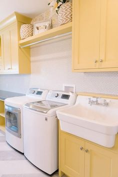 Gorgeous laundry room with yellow shaker cabinets. A great classic style. Visit Laundry Shoppe.com for Your Laundry Room Decor.