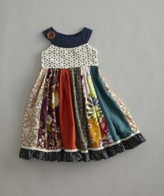 girls field of flowers dress - A rainbow of colors, patterns and textures come together in a delightful dress. The eyelet bodice has a round neckline while polka dot ruffles run around the hem. Field of flowers dress is made in USA.