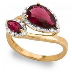 Riddle's Jewelry Garnet & Pink Tourmaline Fashion Ring (03915778) Round diamonds surround deep pink gemstones in this stylish ladies ring. A pear garnet and marquis tourmaline are the center of this wrap style ring.