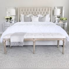 white clean and neutral master bedroom