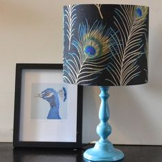 Themis Handmade Peacock Feather Lampshade - dont want one but am amazed by all the eacock furnishing possibilities