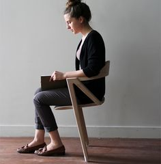 Two-legged chair engages muscles all day
