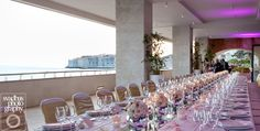 Wedding reception at the terrace of hotel Excelsior in Dubrovnik, overlooking the historic and monumental Old town, all ready for Charlotte's and Eugen's wedding dinner....
