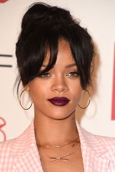 The Lazy Girl's Guide to Easy Messy Bun Hair Ideas | Rihanna's red carpet updo with bangs