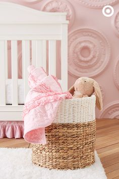 Woven baskets add a natural, casual look, providing nursery storage for blankets, towels, toys and more. This one is a perfect fit for the color scheme.