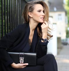 Back to black! The ultimate non-color is the most classical one of all! When you don't know what to wear for any occasion: black works! Coat and pants by Steffen Schraut, Silk Top by Filippa K., Pumps by Christian Louboutin, Clutch by Hermès, Watch IWC Portugieser Chronograph.