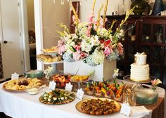 Amazing food table for a gold gender-neutral baby shower! #partyfood #foodtable