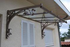 Marquise auvent fer forgé inox contemporaine sur mesure Toulouse fabrication et pose.