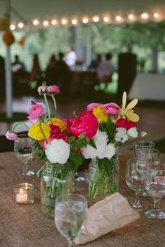 Do It Yourself Floral Centerpieces. I like the colours, I don't care if its only mason jars. Any glass jars would do.