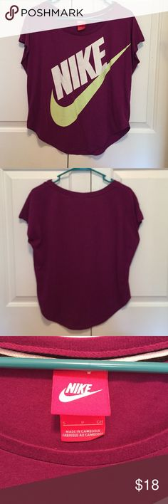NIKE top  This loosely fitting Nike top is a cranberry kind of purple and light neon green. Never been worn. Comes from a smoke free home. Feel free to make offers, but no trades.  Nike Tops Tees - Short Sleeve