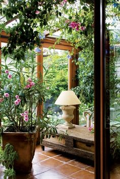 Hope to have a sun room someday in this lifetime. this would make such a good place to read.
