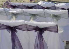 White chair covers allow the sashes to contrast more