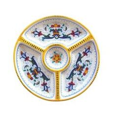 "ANTIPASTERIA (SMALL) (1 PIECE): DERUTA: 10"" (25cm) Diameter    Together with Raffaellesco, this 16th century design is the most classic example of Majolica from Deruta. The pattern is made up of scrolled floral elements from the borders of Renaissance plates divided into sections. The design comes from frescoes by Perugino at the Collegio del Cambio in Perugia. This pattern is important because we see the first use of yellow, orange, and blue.    This Piece is hand painted in Deruta."
