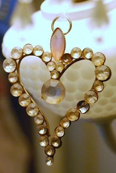 Love it! I love how this pendant sparkles and I love the gems on it. Plus it all works in a shape of the heart. Love. :-)