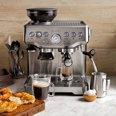 Breville Barista Express Espresso Maker, Model # BES870XL. Built in hopper+ 16 setting grinder for the ultimate crema + 4 included filters + kangaroo storage for parts + quick release magnetic tamper + 4 degree variable temp + floating drip tray warning + included razor + 2013 best new product award! ... my dream machine ;]