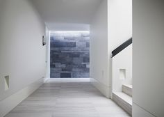 Material focus at the end of a corridor. Walsh Street apartments by australian office B.E. Architecture.