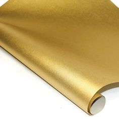 Metallic Gold Mulberry paper http://www.mulberrypaperandmore.com/p-3333-metallic-mulberry-paper-gold.aspx. This shiny gold paper has a crisp smooth surface and is perfect for origami, iris folding and any paper craft!