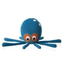Octopus cushion, blue with googly eyes.