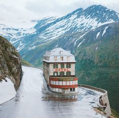 A hotel straight out of a Wes Anderson film. This is the Gletscher Belvedere Hotel, halfway up a pass in the Swiss Alps. It's hard to believe someone imagined putting a hotel in a place like this Hotel Belvedere, Into The Wild, Switzerland Hotels, Alps Switzerland, Unusual Hotels, Destinations, Destination Voyage, Beautiful Hotels, Beautiful Roads
