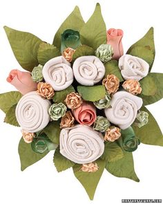 DIY Baby Bunch Bouquet #tutorial http://www.marthastewart.com/270727/baby-bunch-bouquet --   New moms are sure to appreciate the blooms in this unique bouquet made of baby clothing and fabric roses.