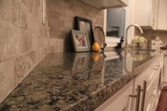 Best White Kitchen Cabinets New Caledonia Granite Countertop 400 x 300