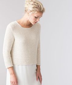 A terrific pullover knit in Shibui's Cima and Twig in a lattice-like stitch pattern. A simple structure keeps it effortlessly stylish. Lightweight, cropped hem.