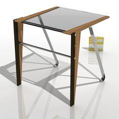 Diciembre 2016. Mesa DANZA WZ. Diseñada por Ernesto Oñate. Cristal, acero y madera maciza de Zebrano y Wengué. Tfno: 603774475.