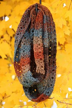 "One of my favorite patterns. Infinity scarfs are now my new favorites.  Used the exact same yarn - lion brand tweed in ""woodlands"". My son like it so much he wanted one. Also made it in lion brand tweed - ""caramel"" too. Have made 4 so far. Friends love it!  Takes about 2 hours once you learn the pattern. Easy beginners scarf!"