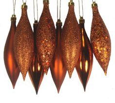 $5.99-$9.99 Orange Finial Drop Christmas Ornament Pack  Item #N500118 8-piece set  Color: burnt orange  These dazzling ornaments are done in 4 amazing finishes: shiny, matte, glitter drenched and holographic glitter sparkle Shatterproof ornaments combine the beauty and luster of real glass with the unbreakable practicality of plastic   Ornaments are equipped with gold ornament caps  Come ready-t ...
