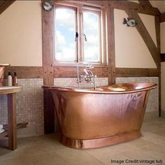 10 Copper Bathtubs For the Most Luxurious Soak - Copper Bathtubs Are the Statement Piece Your Bathroom Needs