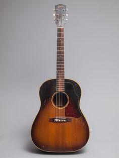 1957 Gibson J-45 in very good condition. Beautiful dark sunburst finish, nicely figured Brazilian rosewood fingerboard.