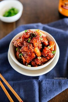 Korean style popcorn chicken garnished with sesame seeds and green onions