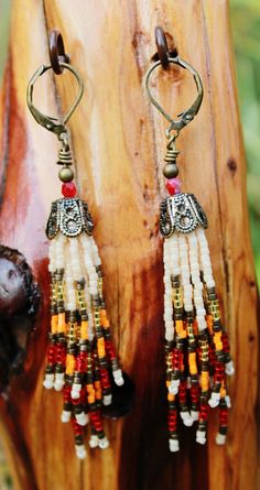 Seed bead earrings, tassel, beaded, hand stitched, fringe, handmade, multicolored, long, dangle, colorful, boho, bead, Native American inspired, bronze, hippie, tribal on Etsy, $25.00