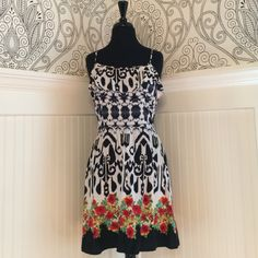 Ikat and Floral Patterned Dress Black and white Ikat pattern on top and Floral pattern at hem. Zip back, and adjustable spaghetti straps. Ruffle on the bodice. 100% Rayon. Adorable!!! Xhilaration Dresses Mini
