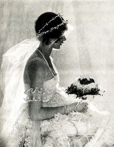 Photograph of 15-year-old Natica Nast (Condé Nast's daughter) modeling this dainty floral crown, filmy veil, and light-as-a-feather gown.  The photo, taken by Baron de Meyer,  was originally published in the January 1920 Vogue. (The couturier Tappé complained about having to make the gown small enough to fit Natica, saying he would not be able to sell it afterward; however, a few months later it was worn by tiny Mary Pickford for her marriage to Douglas Fairbanks.