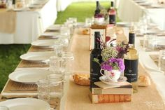 Tent wedding with rustic features such as burlap, teacups and fall coloured books