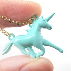 Mythical Creature Unicorn Shaped Pendant Necklace in Mint Blue from DOTOLY