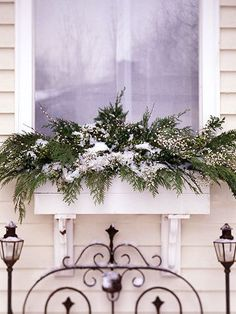 Such a beautiful window box idea for christmas or just for Windows for cold climates