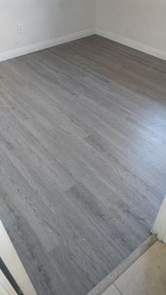 Before and after photos of a Plank Vinyl installation in Midland Gray color. Grey Wood Tile, Grey Wood Floors, Wood Tile Floors, Living Room Wood Floor, Living Room Flooring, Bedroom Flooring, Grey Vinyl Plank Flooring, Vinyl Wood Planks, Interior Design Masters