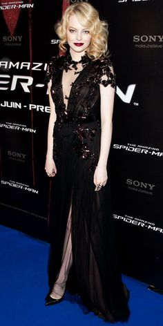 06/20/12: Wine-stained lips and unkempt waves added femme fatale drama to #EmmaStone's smoldering look. #lookoftheday http://www.instyle.com/instyle/lookoftheday/0,,21176115,00.html?count=2#