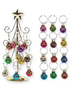Festive fashion meets function with this clever Christmas tree wine charm set. Guests at parties and cozy gatherings can pick a holiday charm from the tree to personalize their delicious drinks and cheerful cocktails.